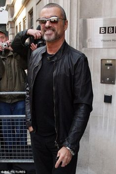All is well: George Michael, pictured outside the BBC Radio Two studios last week, said the newspaper was 'lying through its teeth'