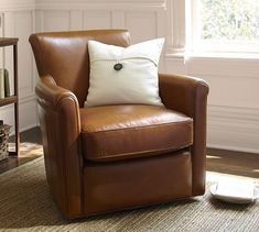 Irving Leather Swivel Armchair, Our compact version of the classic club chair offers all the comfort of the original but in a smaller swivel chair silhouette that's just right for a library, den or small living room. Leather Swivel Chair, Small Swivel Chair, Swivel Recliner, Leather Club Chairs, Swivel Glider, Small Chairs, Leather Sofas, Tan Leather, Upholstered Arm Chair