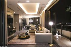 The luxury property boasts a spacious lounge with a balcony overlooking the city. 'The apa...