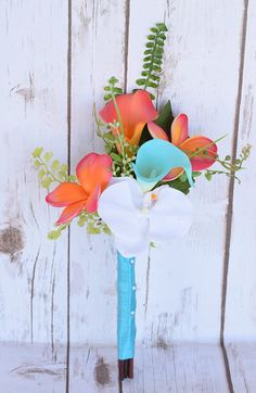 This is a beautiful -almost fresh- Coral Orange and Teal Turquoise Mix of Orchids, Calla Lilies and Plumerias Natural Touch Small Wedding Bouquet, made