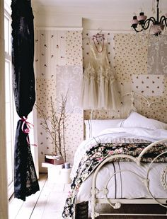 i love the black, lace curtain and bedspread on otherwise light room. I love, in my decor style, black as an accent colour.