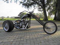 Trike on Harley Davidson base. Bare metal rider.