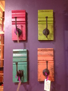 Old hooks and wood create colorful wall hangings for your home