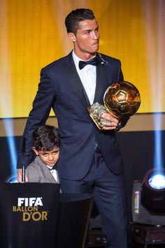 FIFA Ballon d'Or winner Cristiano Ronaldo of Portugal and Real Madrid and his son Cristiano Ronaldo junior stand on the stage after the FIFA Ballon d'Or Gala 2014 at the Kongresshaus on January 12, 2015 in Zurich, Switzerland.