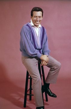 Andy Williams~ a classic picture; Sweater, Slacks, and a stool.