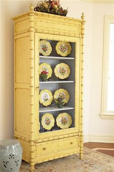 Yellow painted cabinet with plate display @Maggie Yant.. With blue plates instead of yellow on yellow,,,