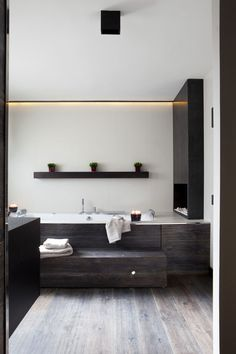 wooden bath with step and shelf above