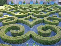 This formal garden consists of carefully sheared boxwoods, both seen at the Chateau de Brecy in France