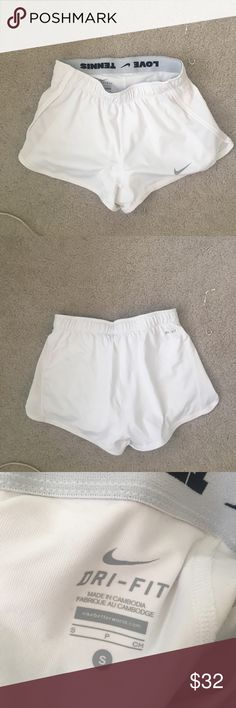 Women's Nike shorts Comfortable white shorts perfect for working out! Comes with a spandex lining. Runs smaller so would fit xs-s Nike Shorts