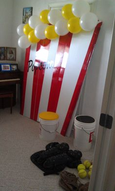 Set up a fun photo-booth area where we took pictures of all the guests. We had a bunch of baseball gear sitting out so they could dress up or hold baseball bats/gloves...etc.