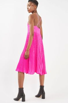Steal the show this party season in this sequin midi dress in an eye-catching bright pink. With barely-there skinny straps, it comes with a deep v neckline and with a pleated design to the skirt. Just add heels and an oversized clutch to compliment the look. #Topshop