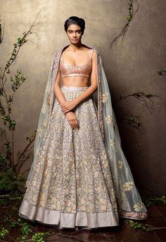 This orchid hush panelled tulle lehenga with beautiful orchestrated pastel hues and sequin shimmers is teamed with gold encrusted choli and slightly contrasting dupatta with rich gold embroidered borders.  Sales@shyamalbhumika.com  www.shyamalbhumika.com