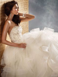 Bling at the top thick tulle ruffles at the bottom. Sweetheart neckline; I love this dress
