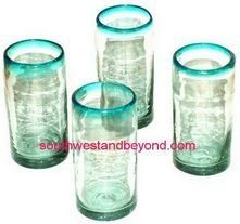 Mexican Bubble Glass - Mexican Glassware Pitcher Sets and Glasses . $22.00. You will love these traditional hand made mexican drinking glasses made from clear bubble glass and an aqua rim, pinched to form four indentations around for a better hold. These will look great in your home either for everyday use or for special occasions. These glasses are sold in a set of four, so the price shown is for four glasses. Due to the hand made nature of our glassware please expect slight var...