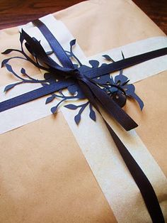 Plain brown paper...but look at the navy blue cut-out and ribbon...wow...I would love to receive this gift..I would be saving that cut-out for my inspiration board!