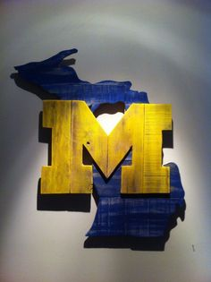 Handcrafted wooden state of Michigan with University of Michigan logo made from pallet wood. Dimensions are approximately 24x27 inches. The products displayed on this website are not endorsed, sponsored or approved by or affiliated or associated with any individual or entity including without limitation any college or university. Because each of our pieces is hand cut from wood that can have a rough texture, knots, small cracks or other imperfections that add to its rustic nature, paint...