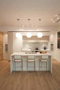 AyA kitchens modern kitchen space in soft neutral tones and textures.