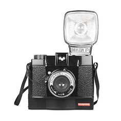 """DIANA INSTANT CAMERA $139  5"""" L x 4"""" W x 8"""" H Notes Diana Instant Camera includes flash adapters, colored gel flash filters, 55mm wide angle lens, close-up lens, lens caps for 55mm and close-up lens, strap, and instruction manual."""