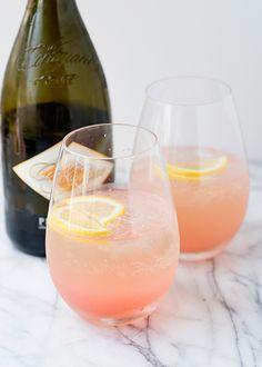 Rhubarb Fizz    8 ounces gin  9 ounces rhubarb syrup  1/2 cup fresh lemon juice  12 ounces cold Prosecco  ice  lemon rounds for garnish