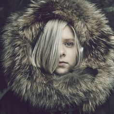 I imagine Finney with her hair that doesn't let her see anything and a big hood. Just like Aurora.