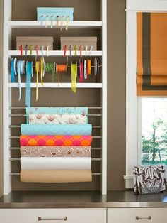 Use tension rods to transform a bookcase into the perfect crafts and gift-wrapping station. More Ideas: www.bhg.com/...