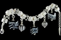 silver plated items: bracelet with lobster, enamel beads with cubic zirconia, balls, locks, five glassdangles.
