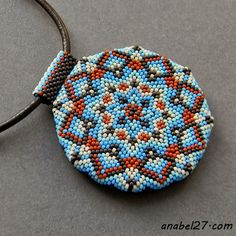 "Two-sided pendant ""Kaleidoscope""  For a long time I have looked at such mosaic roundels and braided mirrors, and finally learned to do them too :) After a series of experiments with delicacy, I finally came to use a round bead for weaving a mosaic circle (or more precisely, an octagon). The wooden blank is braided with the smallest Japanese beads Toho 15/0. On the one hand - an ornament, on the other hand - an openwork weaving (lining - skin). The pendant is suspended on a lace of…"