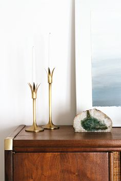 vintage dresser, bedroom update // smitten studio. Lily candle holders and agate bookends - West Elm.