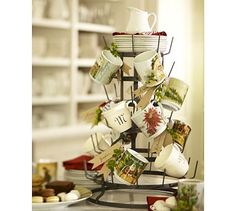 Laden with mugs, our stand makes a creative, self-serve hot beverage station that takes up very little space. The rustic frame is modeled after French bottle trees used to dry wine vessels. Make a dramatic display at holiday brunches and parties b… Christmas Mugs, Christmas Time, Christmas Crafts, Kitchen Island Decor, Kitchen Sink, Kitchen Ideas, Mug Tree, Bottle Trees, Rustic Christmas