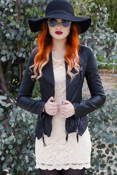 This moto jacket is a sleek and chic cover-up that would be great paired with a dress or jeans alike. Featuring a cropped fit, edgy zippers, and a ribbed design along the body of the jacket. $156 at Obsezz.com.