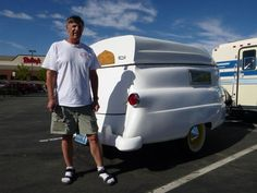 1952 Kom-Pak Sportsman trailer comes with a boat as a rooftop...cool