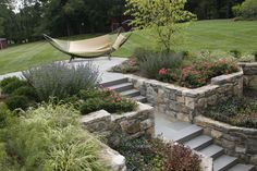Bluestone steps and stone wall planters. Statile & Todd