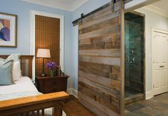 The Finn master suite features a door made of reclaimed cypress.