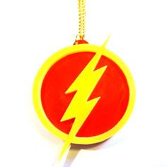 'Putting on the scarlet and the lightning is usually instinctive. I can do it in less than a millisecond.' Channel your inner superhero with this The Flash symbol pendant, fashioned from double layer 3mm laser-cut acrylic. On your choice of 46cm silver or gold plated chain, or black leather thong. Measures approximately 45mm x 65mm at widest point. Nickel and lead free.