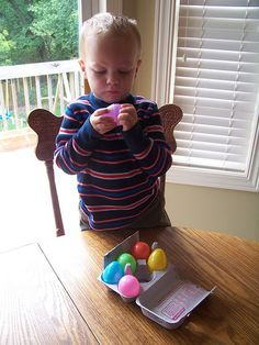 great play kitchen idea - plastic easter eggs in an egg carton.  geeeeez.  of course!