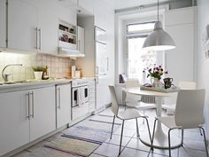 #simple kitchen #white #lamp #dining area in the kitchen