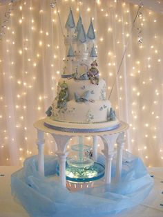 https://flic.kr/p/7rAoQT | WEDDING CAKE GRIMSBY | A fairytale castle on top of a water fountain with a spectacular light curtain from Fairytales Grimsby.Cake by KC Wedding Cakes and Cupcakes Grimsby Lincolnshire.