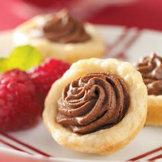 Chocolate Ganache Tarts Recipe ... Decadent, chocolate mousse-like filling and a flakey, tender crust make this very special. Be sure to coat hands well with flour when putting the dough into pastry cups.