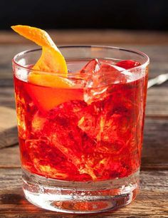 Negroni sbagliato: bright red cocktail served in a glass tumbler with an orange twist