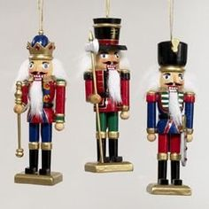 """Kurt Adler Wooden Nutcracker Ornament Set of 3 by Kurt Adler. $14.99. * Made of wood * 5"""" tall * Set of 3 * Kurt Adler item # C0052 Take the nutcrackers from the mantle and bring them to the tree this year with the Kurt Adler Wooden Nutcracker Ornament Set of 3! Each of these 5"""" nutcrackers is sporting a bushy white mane of hair and a beard. All three wear the classic high black boots and are standing on gold square platforms. One of the set wears blue pants and a red coat with ..."""