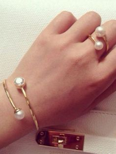 Faux Pearl Bangle Bracelet and Ring Pack kind like this. Kinda edgy and lady like Diamond Bracelets, Ring Bracelet, Pearl Bracelet, Pearl Jewelry, Silver Bracelets, Bangle Bracelets, Silver Jewelry, Bangles, Pearl Rings