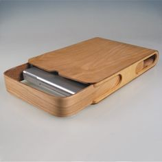 Gorgeous plywood laptop case by via NOTCOT. This project is an exploration into the process of bending plywood. The laptop case is formed from two bend panels of plywood which slide along one anoth...
