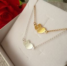A personal favorite from my Etsy shop https://www.etsy.com/listing/571366181/heart-necklace-silver-two-hearts
