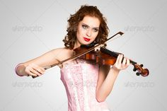 young attractive woman in pink corset on a violin ...  acoustic, adult, alone, art, artist, background, beautiful, beauty, black, bow, caucasian, classic, clothing, color, corset, cute, dress, elegance, fashion, female, fingers, hair, image, instrument, lady, model, music, musical, musician, one, performance, performer, person, pink, play, portrait, sensuality, sound, string, studio, stylish, vintage, violin, violinist, woman, women, young