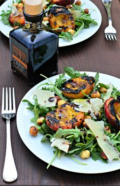 Grilled peaches and toasted hazelnuts over arugula makes an amazing, Tuscan-inspired summer salad