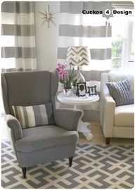 Love the mix of patterns! Ikea Strandmon chair, grey horizontal striped curtains, Overstock indoor/outdoor area rug