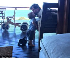 'I'm melting!' Elsa Pataky posted this incredibly cute picture of her husband Chris Hemsworth kissing the head of one of their young twin boys