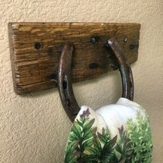 This is a towel holder that I made out of an old horseshoe and recycled pallet wood. Distressed, flame treated, and clear coated for water protection. #wildwoodrusticcustoms