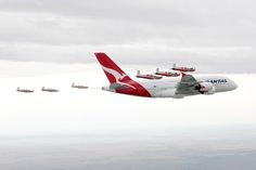 The Royal Australian Air Force aerobatic demonstration team, The Roulettes, escort a Qantas Airbus A380