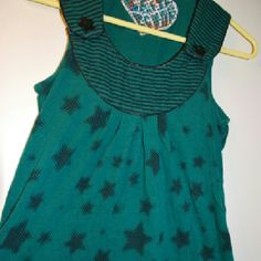 Stars & Stripes Bib Tunic Teal and black tunic with all over star pattern and a striped bib style collar. Has two large non-functioning star buttons as well. SO cute! Made of 60% Cotton, 40% Polyester. Very soft. In very good condition. Says XS but can fit S. Crafty Couture Tops Tunics